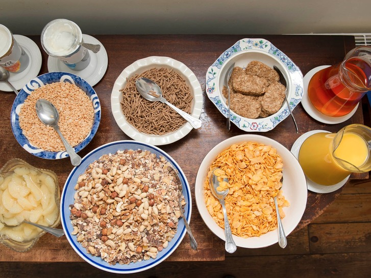 Cereals, fruit and fruit juice,  all ready for breakfast